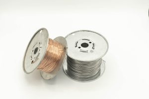 Spools of silver and bronze wire